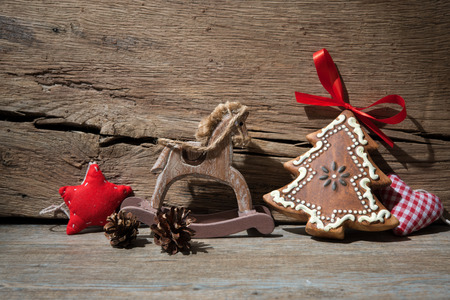 antique background: Vintage christmas decoration over old wooden background Stock Photo