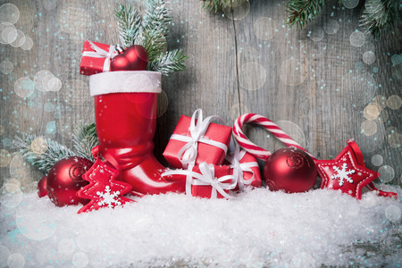 Christmas background with gift boxes over wooden board photo