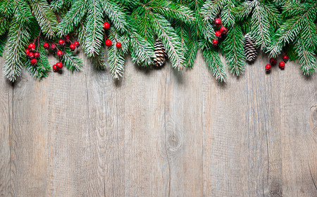 Christmas background with fir tree on old wooden board photo