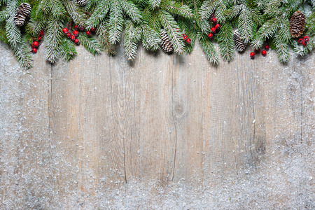 snow and trees: Christmas background with fir tree on old wooden board