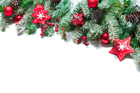 xmas: Fir tree branches with christmas decoration isolated on white background Stock Photo