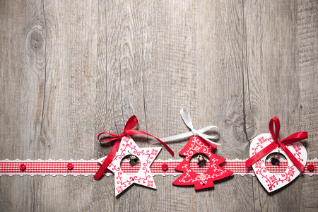 christmas decorations: Vintage christmas decoration on old wooden background Stock Photo