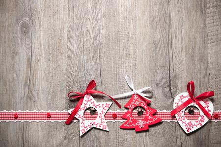 Vintage christmas decoration on old wooden background Standard-Bild