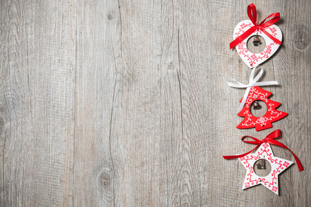 rustic christmas: Vintage christmas decoration on old wooden background Stock Photo