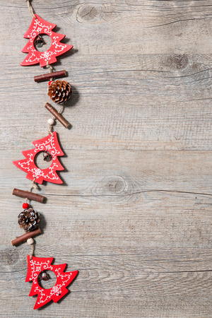 hanging: Vintage christmas decoration on old wooden background Stock Photo