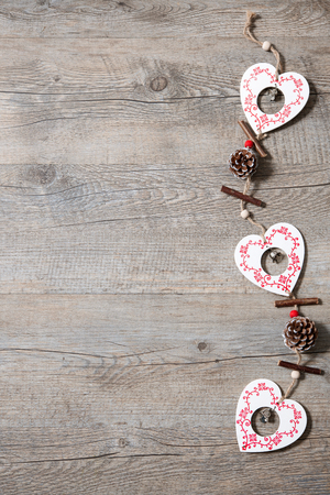Vintage christmas decoration on old wooden background photo