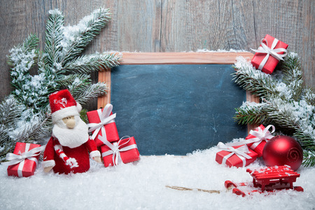 Vintage Christmas decoration with Santa Claus und chalkboard for message photo