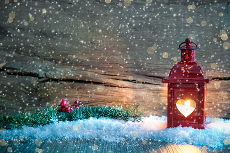 wood backgrounds: Christmas background with burning lantern in the snow