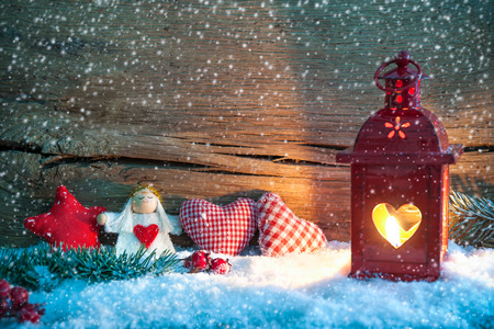 Christmas background with burning lantern in the snow
