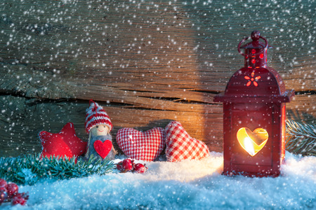 fir: Christmas background with burning lantern in the snow
