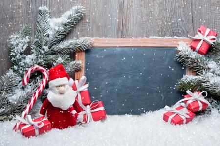 Vintage decoratie van Kerstmis met de Kerstman und bord voor bericht