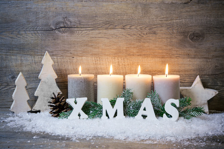 advent time: Rustic Christmas background with four advent candles burning
