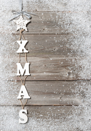 Christmas decoration hanging over wooden background photo