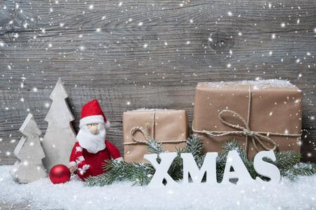 Vánoční pozadí s dárkové krabičky přes dřevěné desce Reklamní fotografie