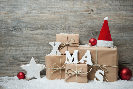 coupons: Christmas background with gift boxes over wooden board