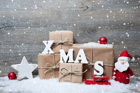 christmas decorations: Christmas background with gift boxes over wooden board