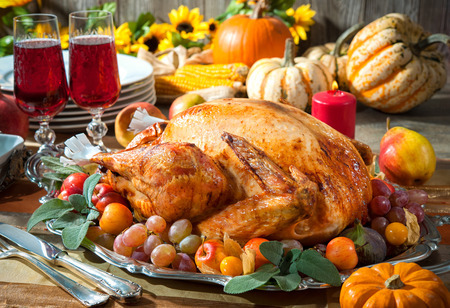 roast turkey: Thanksgiving dinner. Roasted turkey on holiday table with pumpkins, flowers and wine