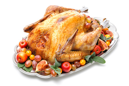 food on white: Garnished roasted turkey on platter over white background Stock Photo