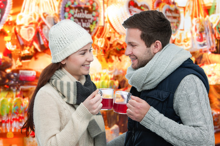 weihnachtsmarkt: Romantic young couple drinking hot wine punch claret on christmas market