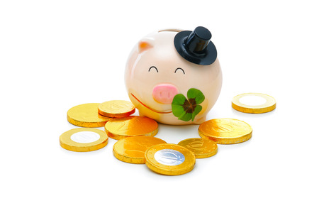 four leafed clover: Four-leafed clover and piggybank with money