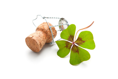 charm: champagne cork with a four leaf clover isolated on white Stock Photo