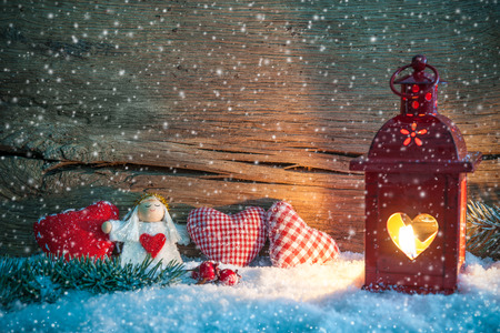 Christmas background with burning lantern in the snow photo