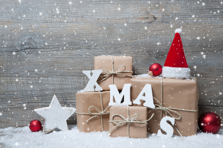 retro christmas: Christmas background with gift boxes over wooden board