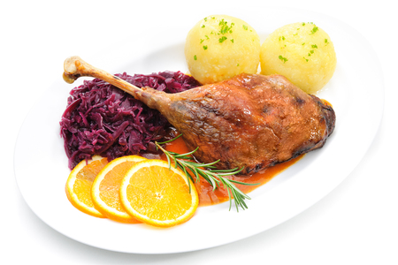 red braised: Crusty goose leg with braised red cabbage and dumplings isolated on white