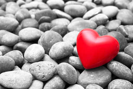 heart of stone: Red hearts on pebble stones, still life. Valentines Day background