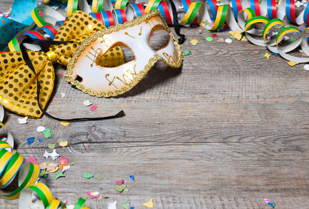 Colorful carnival background with garlands, streamer, party hats, confetti and mask Stok Fotoğraf - 35238697
