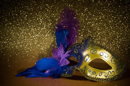 festal: Female carnival mask over gold background Stock Photo