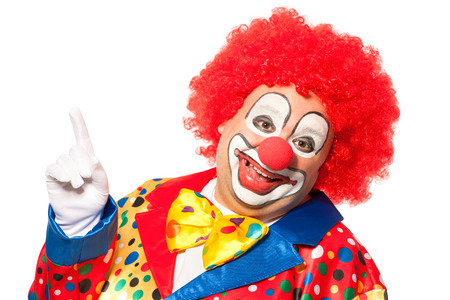 Portrait of a smiling clown isolated on white photo