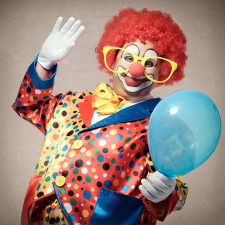 Portrait of a smiling clown with balloon