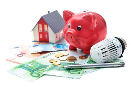 Heizung Thermostat mit Sparschwein und Geld kostet teure Heizungskonzept Standard-Bild - 35639932