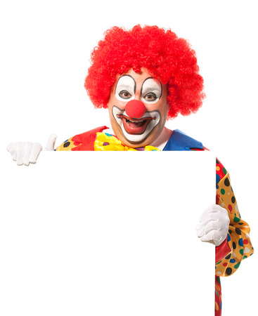 red nose: Clown with blank board isolated on white