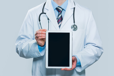electronics equipment: Doctor holding blank digital tablet isolated on white background