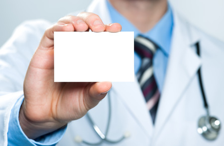 sign: Doctor showing his business card