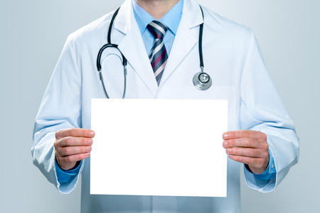 Doctor holding blank white banner photo