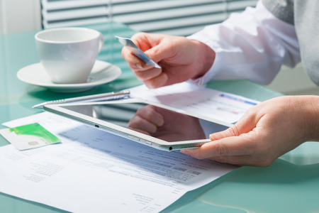 paying credit card: Woman using a credit card and digital tablet for buying on-line Stock Photo