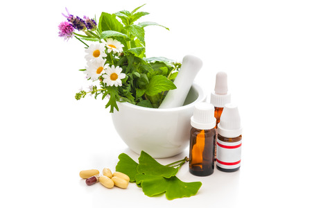 plant drug: Healing herbs and amortar. Alternative medicine concept