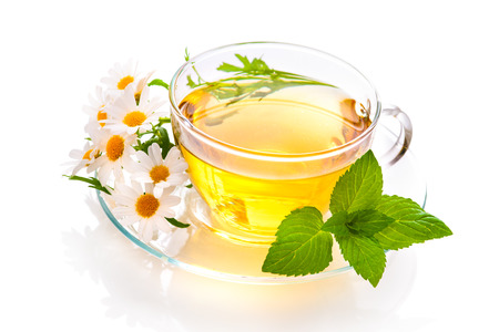 Herbal tea with chamomile and  fresh mint leaves photo