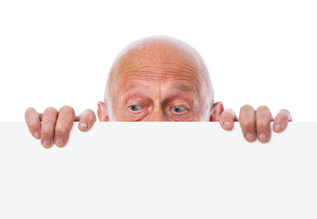 prying: senior peeps over top of blank white paper Stock Photo