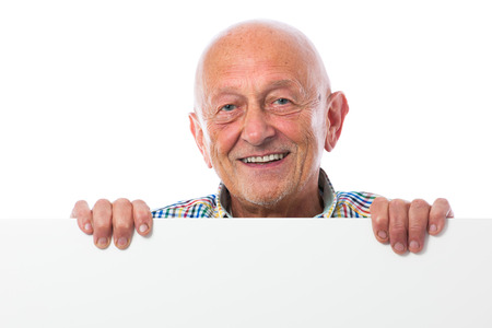 Happy smiling senior man holds a blank board photo