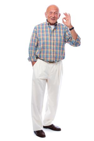 Portrait of a happy senior man smiling isolated on white photo
