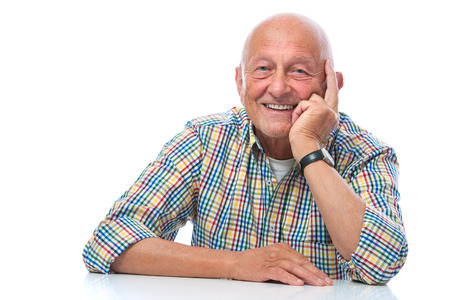 old man smiling: Portrait of a happy senior man smiling isolated on white Stock Photo