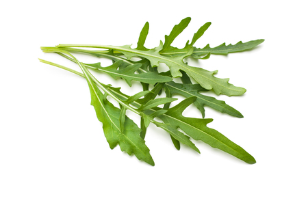 Heap of ruccola leaves isolated on white photo