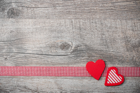 Valentines Day background with patterned hearts on old wooden Reklamní fotografie