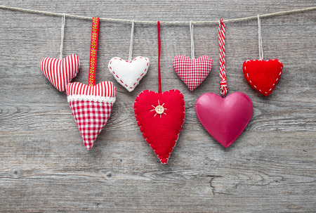 clothesline: Red hearts hanging on clothesline over grey wood background Stock Photo