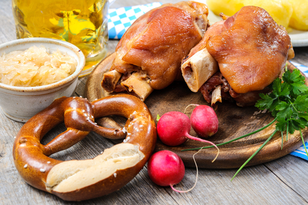 knuckle: Appetizing Bavarian roast pork knuckle on cutting board Stock Photo
