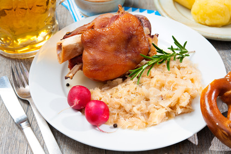 Schweinshaxe (German Pork Knuckle) with pickled cabbage Stock Photo
